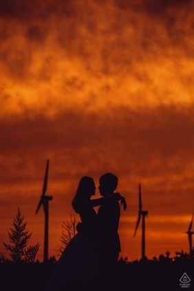 Beijing China PreWedding Portraits at Sunset by Wind Turbines