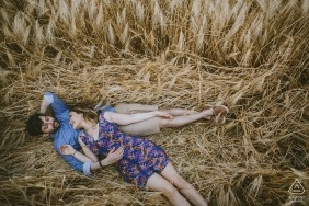 Cappadocia Turkey Engagement Shoot of a couple lying on a long grass field