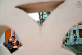 Singapore Engagement photoshoot with kissing couple and geometric shapes