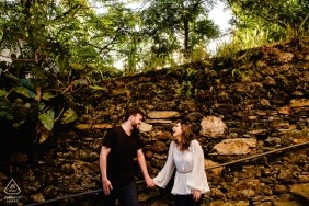 Ouro Preto, MG couple holding hands by rock wall during photo shoot
