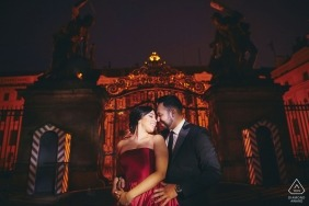 A couple during their very sexy night time engagement photo session at Prague Castle