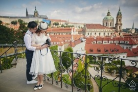 Happy couple during their engagement photography session in Prague captured at the Vrtba Garden