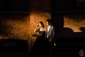 Engagement shoot couple facing the sunlight during dumbo portrait session