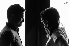 Silhouetted profiles of the newly engaged couple looking at each other. This photo was taken soon after the proposal, inside the Mount Royal Chalet.