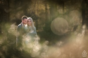 Engaged couple in beautifull lighting during engagement photo session in Uddel- Kootwijkerzand