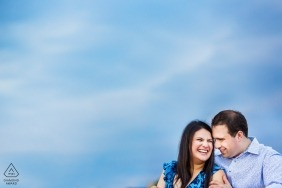 New Jersey engagement session in Hoboken with the bright blue sky over this couple