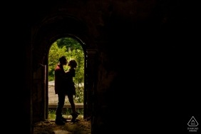 Seven Steps Canyon Brasov Portraits. Engaged Couple in the entrance of an abandoned building near the seven steps canyon In Brasov during photo shoot.