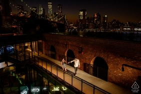 Brooklyn Dumbo Engagement Photos - Couple stroll in Dumbo with Manhattan night view