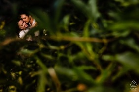 Engagement Portrait from Davis - CA Image contains: afternoon, couple, portraits, green, trees, hug