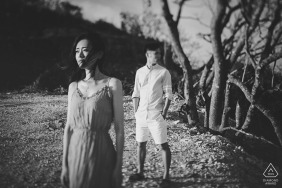 Engagement Portrait from Fujian - Photography contains: engaged couple, breeze, sea, blowing, trees, black, white