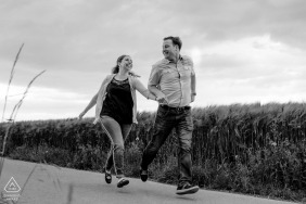 Engagement Photos from Aachen - Image contains: couple, black and white, run, grasses
