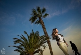 Engagement Photos from Almería - Spain | Image contains: palm trees, couple, sky, clouds