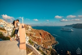 Engagement Photographer for Santorini - Image contains: water, mediterranean, cliff, cruise ship, couple, kiss