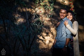 Engagement Photos from Oakland Hill - Couple enjoying the warm sunlight in the woods