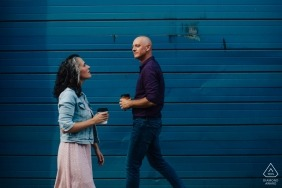 Cherry Street in Philadelphia - Engaged couple walking in front of blue door during portrait shoot