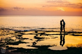 Bali, Indonesia Couple at sunset by the sea during pre-wedding portrait shoot