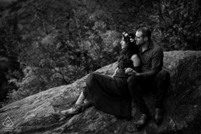 Mont Sourire, Quebec Engagement Shoot - Black and white photo of engaged couple sitting on a rock on a mountaintop