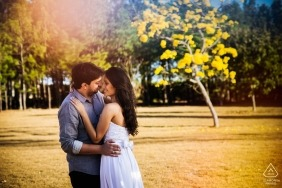 Capitolio - Brazil Couple hugging in the sunlight during engagement photo session for portraits