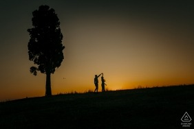 Tuscany, Siena Couple Dancing at sunset during engagement portrait session