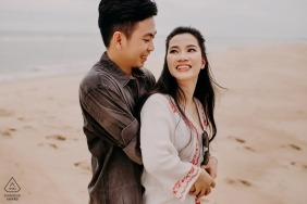 Ho Coc Engagement Photography - Couple having a nice time together in the sand at the beach