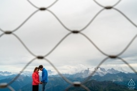 Engagement portraits outdoors above Dolomites, Italy