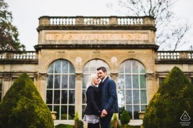 Couple in-front of the orangery at Castle Ashby, Northants for engagement photo session