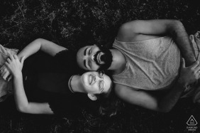 Couple laying down beside each other during engagement session at the Hotel Oberland, Nova Friburgo - RJ
