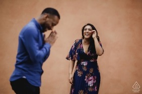 Rome couple messing round in Italy during engagement portrait session.