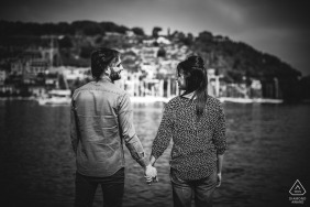 Le grazie - La Spezia Engagement session with a couple holding hands at the water
