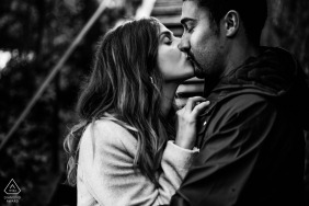 Agen, France black and white couple kissing portrait.