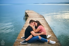 Trasimeno Lake Love Portrait Session - Couple on the Dock at the Water.