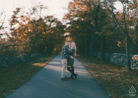 Portrait of a couple as they embrace at the head of a hiking trail. Colt State Park | Bristol RI