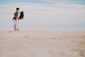 Ho Coc couple Laughing together on the beach during prewedding session.