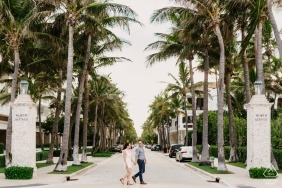 Couple walking down Worth Ave in Palm Beach, FL | Engagement Photography
