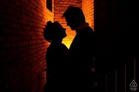 Student home, Leiden, The Netherlands engagement shoot - Silhouette of couple in their lit alley at the student home