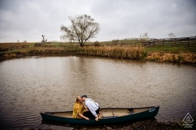 Western Maryland kissing couple in canoe during engagment photoshoot on the water