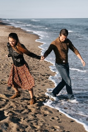 Cape Cod, MA Engagement Photographer | Playing with the waves on the beach in the daylight