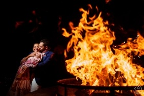 Fethiye, Turkey engagement photo session by the open fire pit at night with flames