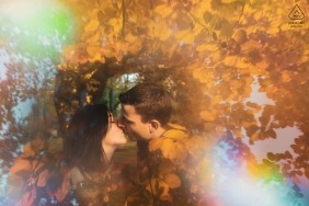 Vittel, France Automnal engagement portrait - Photo Session - Portrait contains: leaves, fall, colors, rainbow, prism, kiss