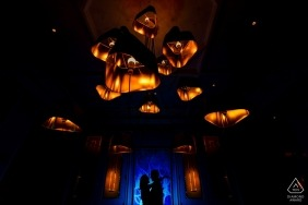 St Regis Beach Resort, Rio Grande PR Engagement Couple Portrait - Image contains: 	Silhouette with a contrast with Blue and the warm color of the Chandelier