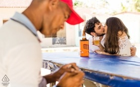 Alagoas, Brazil Engagement Photo Session - Portrait contains: Couple who loves beer doing the pre wedding in a bar