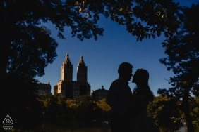 Engagement Session Photography - Portrait contains: Central Park in Manhattan, New York - Silhouette picture with a famous building in the background