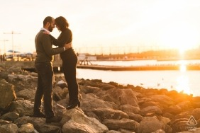 Brooklyn Bridge Park, New York City - Couple pauses for a moment at sunset to think about their relationship. Engagement Photography