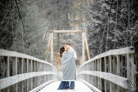 Massachusetts Engagement Couple Portrait - Image contains: snow, covered, bridge, blanket, cold, winter