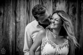 Arcachon Bay Engagement Photography Session - Image contains:black and white, kiss, ear, cheek, hair