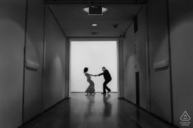 Art Institute of Chicago | couple pulling each other during indoor pre wedding engagement shoot
