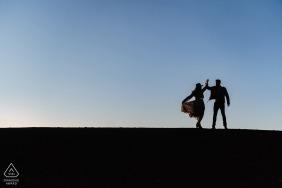 Gladbeck Engagement Session with a couple - Portrait contains: silhouette, dancing, low, horizon, black, blue, hat