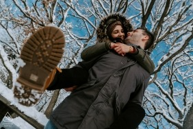 San Marco Mtn. Engagement Picture Session - Portrait contains: snow, trees, piggyback, hug