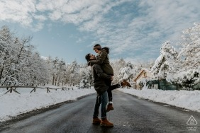 Mt. San Marco Engagement Session Photography - Portrait contains: couple, snow, winter, roadway, street, trees, clouds