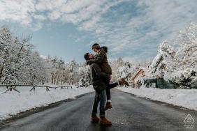 Mt. San Marco Engagement Session Photography - Portrait contains:couple, snow, winter, roadway, street, trees, clouds